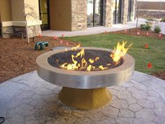Fire glass fire pit ideas for custom outdoor stone fireplace designs. Stone Fireplace Designs, Fireplace Glass, Glass Fire Pit, Fire Pits, Camping Fire Pit, Outdoor Stone Fireplaces, Outdoor Fire, Outdoor Decor, Yard Crashers