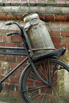 "I remember seeing these when I was a child in the fifties, visiting my relatives in Holland, either in Delft where Tante Willie lived, then, or in Amsterdam where Tante Jopie and aslo where Oma en Opa resided.  ""An old bicycle at the old dairy factory Freia, Openluchtmuseum, Arnhem, Nederland."""