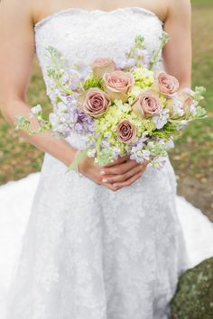 Charleston destination wedding at White Point Gardens and the Old Exchange Building & Provost Dungeon photographed by Charleston wedding photographer Priscilla Thomas. Strapless wedding gown. Wedding colors of lavender and pistachio.