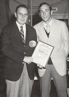SGA president Dick Nash presents Fred Davis with a plaque proclaiming Dec. 15-19, 1969 to be Fred E. Davis Appreciation Week.