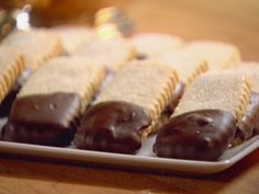 Chocolate Dipped Shortbread Cookies - Recipe courtesy of the Barefoot Contessa - Absolutely delicious, and really, ridiculously easy to make....I went a little nuttier with the chocolate than she did, but that's just me and my chocolate addiction!