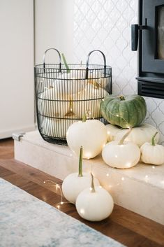 A pretty and subtle Halloween Mantle. White pumpkins, twinkle lights and a mini banner make this mantle holiday ready while staying classy. Halloween Porch, Scary Halloween, Fall Halloween, Halloween Ideas, Pretty Halloween, Halloween Fireplace, Halloween 2020, Halloween Nails, Classy Halloween Decorations