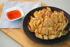 Making a blooming onion is not as difficult as it looks. These step by step pictures will take you a long way.