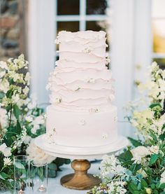 With blush frosting, ruffle detailing and floral accents, this cake is almost too pretty to eat! Just kidding, we'll have two slices,…