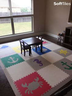 A fun color combination for this playroom. SoftTiles Light Gray and White Mats are used to offset the brighter primary colors. The shapes used in this children's play mat are from our Nautical and Sea Animals Collections. Create your own custom playmat at SoftTiles.com #playroom #playroomdecor #nursery #nurserydecor #softtiles