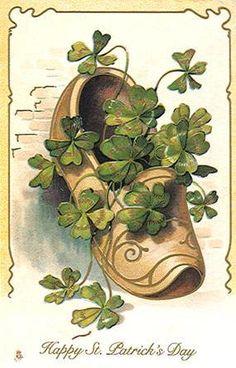 Happy St. Patrick's Day. Clog full of shamrocks.