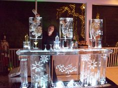 Christmas themed ice bar with snowflake ice luges