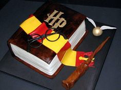 Harry Potter Book Birthday Cake We had another request for our Harry Potter book cake. It is a chocolate cake with a cream cheese filling. Harry Potter Theme Cake, Harry Potter Torte, Cumpleaños Harry Potter, Harry Potter Birthday Cake, Birthday Cake Decorating, Cookie Decorating, Cupcakes, Cupcake Cakes, Hery Potter