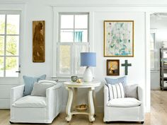 A cozy living room and entryway is essential to this North Carolina cottage. Small-scale furniture fits this space perfectly, and blue accents are classically coastal. (Photo: Deborah Whitlaw Llewellyn)