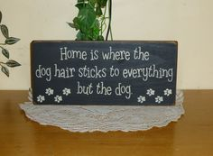 """Home is where the dog hair sticks to everything but the dog"" wood sign -  $9.99 - Etsy."