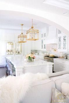 white marble kitchen with white walls
