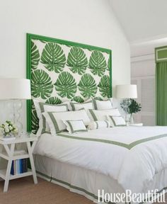 If flower power isn't your thing, add greenery with a statement piece. The botanical headboard delivers this bedroom's knockout punch. Click through for more summer decorating ideas.