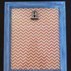 painted goodwill frame, scrapbook paper, hot glue clip for ever changing photo display