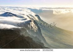View of Table Mountain covered in clouds at sunset, South Africa - stock photo
