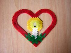 un coeur avec une bougie a l'interieur $) ce mobelle vient du livre hama :D