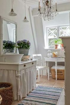Delicate and whimsical bathroom. A touch of vintage with added class.
