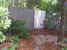 Privacy fence made out of old shutter.  Nice way to recycle and have a fence at little to no cost.