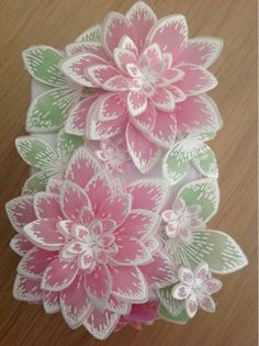 Heartfelt Creations Sun Kissed flower dies and stamps. She stamped on parchment / vellum & embossed them with pure white embossing powder, Then she colored on the reverse side with pro markers and then cut out everything, using the dies.  Papercrafting.  #RubberStamping  @hcofficial