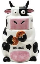 cow shaped cookie jar of a cow eating Milk and Cookies