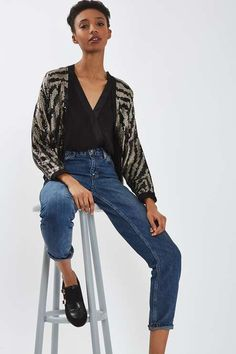 Kick off the festive season by investing in a luxe trophy jacket. This piece comes in black with an all-over tiger-stripe sequin design with cropped sleeves and an open front for a relaxed style. Wear casually with jeans and a strappy top or with a statement party dress. #Topshop