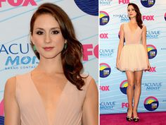 Troian Bellisario (Spencer Hastings) knows how to work a red carpet.  We love this simple cream dress with the pop of color in her jewelry for the Teen Choice Awards.  What do you think?  Re-pin with your comments!
