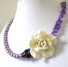 Day of the Dead Jewelry Sugar Skull Necklace White Rose Lilac Purple Faux Pearls. $29.99, via Etsy.