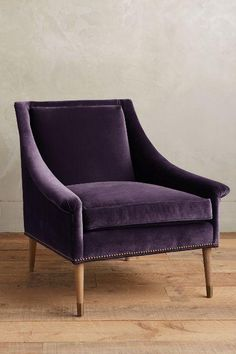 Seating - This velvet-upholstered seat distills the elegance of classic English furniture into one comfy, contemporary respite. Low, sloping arms ensure that cocktails or coffee on your side table are always within easy reach.