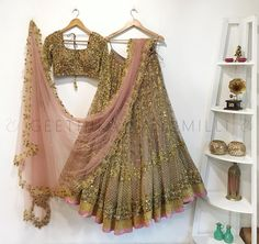Stunning gold lehenga and blouse with blush pink color net dupatta. Blouse with full sleeves. Lehenga and blouse with hand embroidery gold thread work. Geethika Kanumilli best seller this season. Indian Bridal Outfits, Indian Bridal Lehenga, Indian Bridal Wear, Indian Designer Outfits, Gold Lehenga Bridal, Indian Wear, Designer Dresses, Half Saree Lehenga, Choli Dress