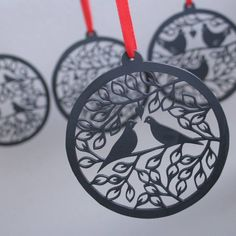 christmas bauble decoration set wooden laser cut by louise mclaren | notonthehighstreet.com