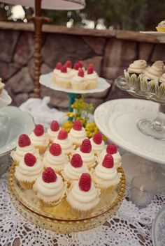 lemon raspberry cupcakes on vintage cake stands