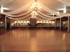 Reception Hall - for a more colorful theme, I will use white tulle with multi-colored string lights on white wire rather than white lights.