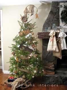 I love the old car tags and the entire rustic feel of this decor...including the bags hanging from the mantel in lieu of stockings. <3  Funky Junk Interiors: A Christmas like no other (2010 story)