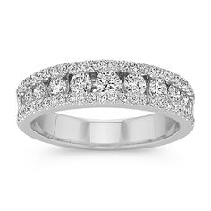 Dazzle her with this classic wedding band complete with diamonds of varying sizes as the center isle is also outlined by diamonds. Sixty-three round diamonds, at approximately .78 carat total weight, are crafted in quality 14 karat white gold to create this spectacular band. Each diamond has been hand-matched for consistent color and brilliance.