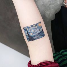 "Vincent van Gogh's ""The Starry Night"" inspired tattoo on the left inner forearm. Tattoo artist: Ida"