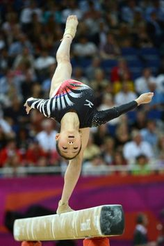 Japan's gymnast Asuka Teramoto performs on the beam during the artistic gymnastics women's individual all-around final at the 02 North Greenwich Arena in London on August 2, 2012 during the London 2012 Olympic Games.