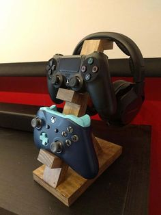 This controller and headphone stand is uniquely handmade! They make great gifts for any occasion. 1 controller stand is Wide, inches. Depth 2 controller stand is Wide, in. Depth 3 controller stand is wide, Diy Headphone Stand, Wood Projects, Woodworking Projects, Woodworking Machinery, Woodworking Tools, Diy Headphones, Video Game Rooms, Gaming Room Setup, Gaming Rooms