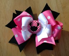 Minnie Mouse bow with Minnie Mouse bottle cap center . $9.00, via Etsy.