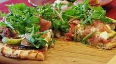 Fig and Goat Cheese Pizza with Prosciutto and Arugula,goat cheese,arugula,prosciutto,fig jam,caramelized onions,balsamic glaze,Black Mission...