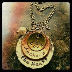 """*SALE* New!! Love anchor heart stamped necklace Brand New!! Handmade hand stamped stacked pendant on an 18"""" chain. Largest disc is silver & 1 1/4"""", middle disc is copper & 3/4"""", smallest disc is antique gold & 1/2"""". Small pearl dangle also included. Jewelry Necklaces"""