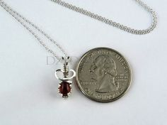 Wow!  So small yet so much detail.  Look at the deep red garnet...so pretty:)