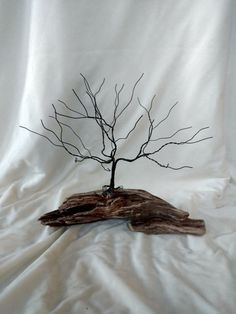 Hand crafted wire sculptures. Each piece is a one of a kind art selection. Piece you will receive is the one pictured in this ad. This is a Black Annealed Wire piece that measures 13X11X12 inches. It is mounted on a piece of Lake Superior driftwood. This piece can also be used as a jewelry display piece.