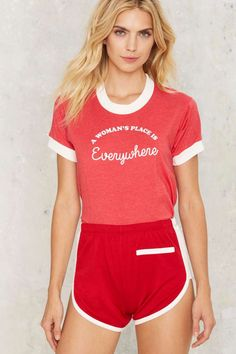 Who run the world? The Woman's Place Tee by CAMP Collection comes in red and features a classic t-shirt silhouette, white ribbed crew neckline, white c