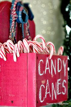 12 Days of Christmas Candy Cane holder http://bec4-beyondthepicketfence.blogspot.com/2014/11/12-days-of-christmas-day-1-candy-cane.html