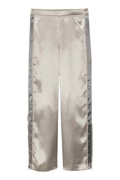 Wide trousers with side stripe