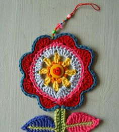 This cute crochet ornament is a great way to bring a touch of spring into your DIY Christmas decorating. Make a great crochet Christmas project with this adorable ornament.