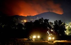A U.S. Forest Service hotshot crew sets up camp as the Rim fire burns about three miles east of Tuolumne CIty, CA. (Don Bartletti/Los Angeles TImes)