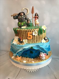Moana cake complete with ocean scene, rock monument, the heart of Tafiti and these great characters from Bullyland.  The Princess & the Cupcake