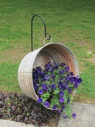 wash tub hanging on a hook with petunias..  https://sphotos-a.xx.fbcdn.net/hphotos-ash3/481338_444671398945727_1680772046_n.jpg