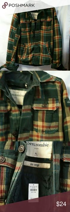 """Abercrombie jay range jacket. Plaid XL This is a new with tag, never worn, Abercrombie jay range style plaid green jacket. Boy's size XL. Dark green denim trim, lightweight quilted lining. 4 pockets in front. Measures approx. 26"""" in length. Sleeves measure approx. 28"""" in length. Chest measures 36"""". Fits a womens size medium. abercrombie kids Jackets & Coats Utility Jackets"""