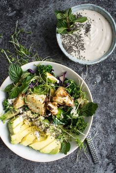 A feel good bowl packed with greens, roasted cauliflower and a creamy, tahini dressing